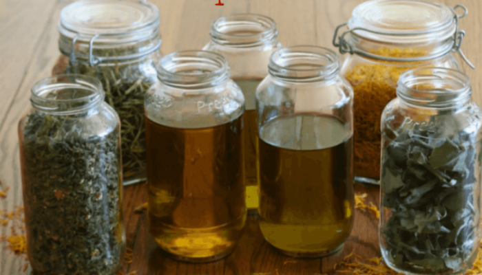 Make Your Own Herbal Infused Oils for Life's Bumps & Bruises